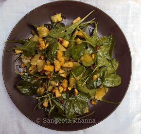 A salad for lunch, garden fresh baby spinach,sweet lime,tofu and pistachios in a tangy sweet medley ...