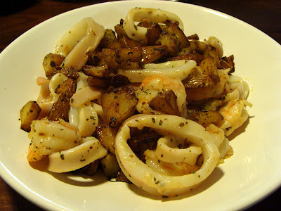 sauteed potatoes with prawns and squid
