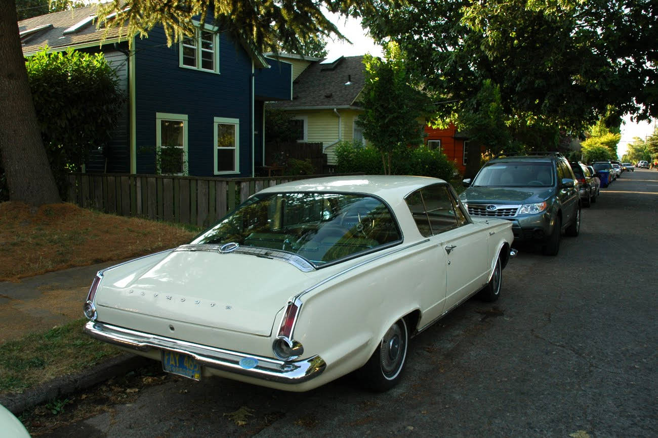old parked cars 1964 plymouth barracuda