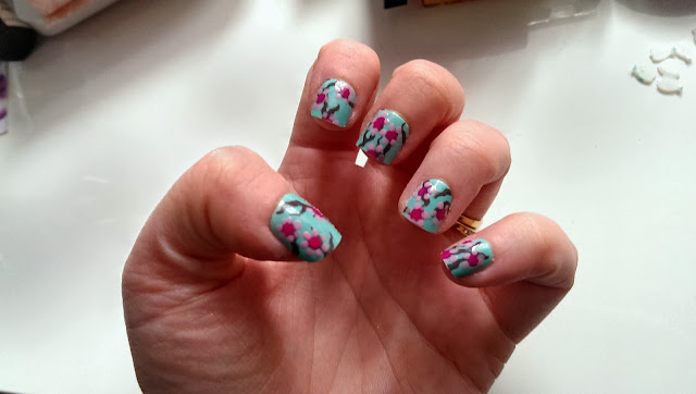 Custom cherry blossom nails after being filed down