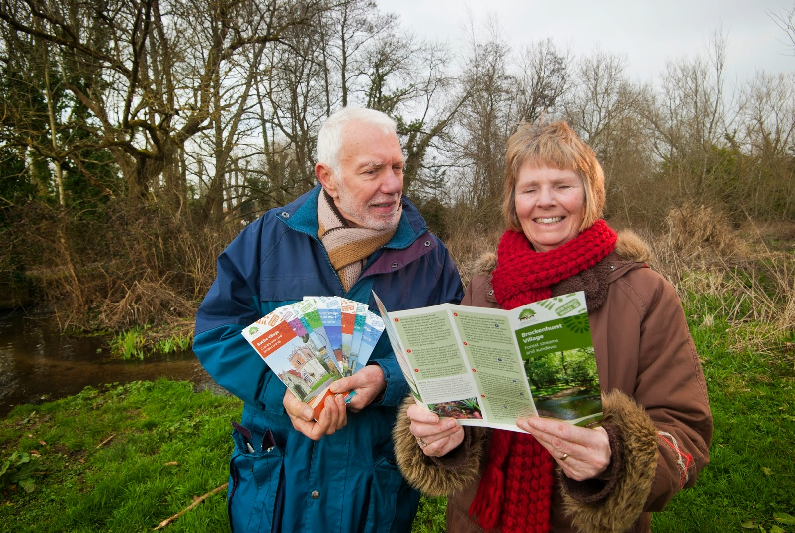 New Forest Walks Leaflets being read by two keen walkers