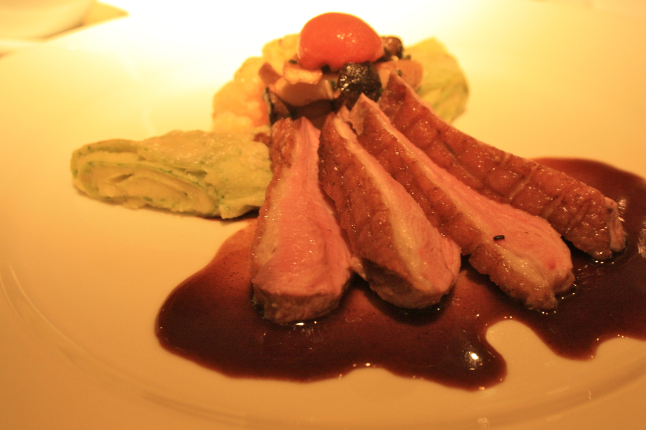 : Duck breast with sides of spicy cauliflower, sautéed mushrooms ...