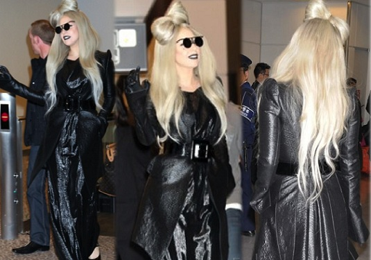 9881a1e186ac Lady Gaga was seen wearing an archive Moschino black gown at the Narita International  Airport in Tokyo