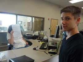 rye signing paperwork to get his license