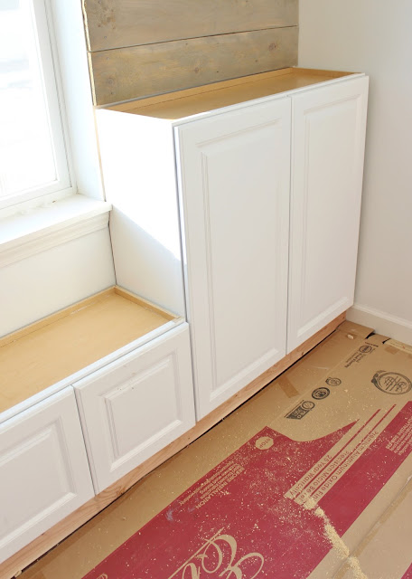 DIY built-in with decked out stock cabinets. What a terrific way to add stylish and functional storage to a room! Step-by-step tutorial included.