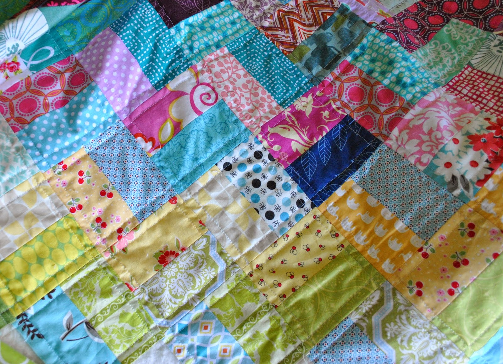straight line quilted scrappy chevron quilt