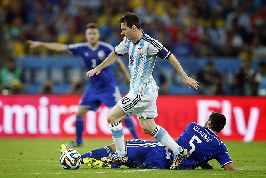 Argentina's Lionel Messi strolls past Bosnia's Sead Kolasinac during the group F World Cup soccer match between Argentina and Bosnia at the Maracana Stadium in Rio de Janeiro, Brazil, Sunday, June 15, 2014.