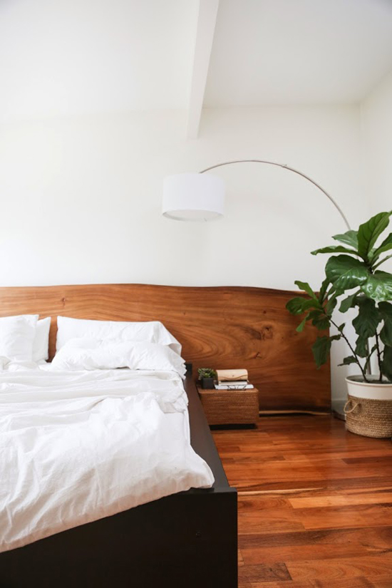Wood slab headboard | Image by Ashley Bruhn via A Cup Of Jo.