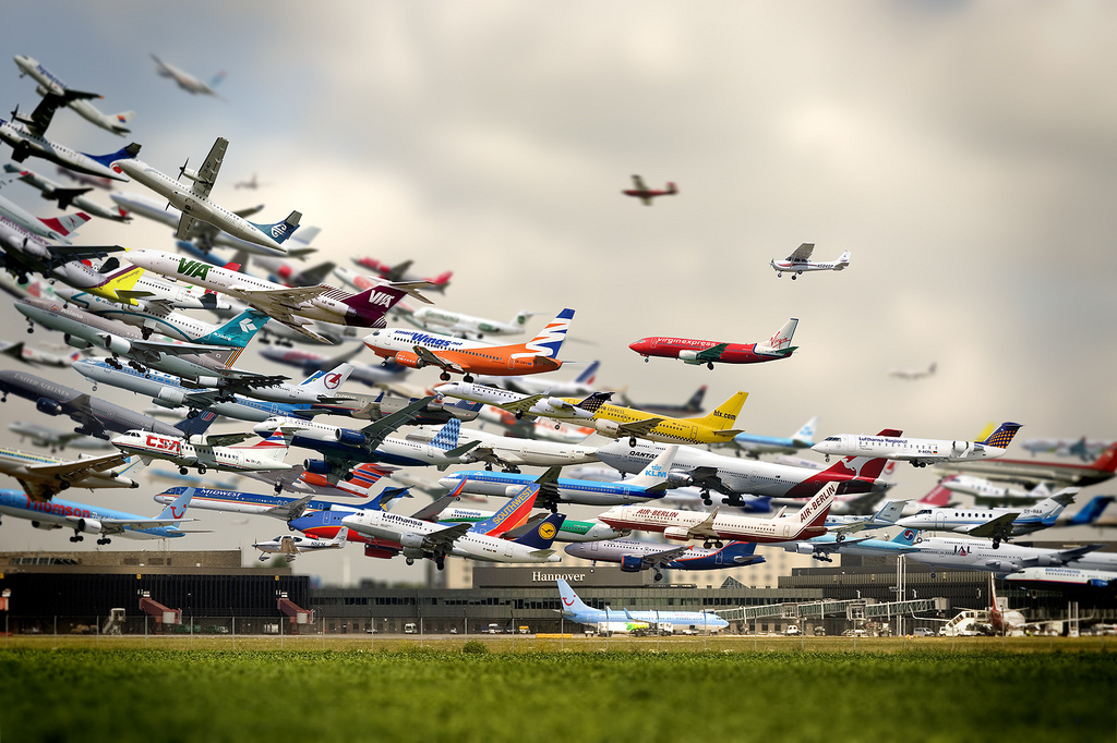 Planes and jets taking off from an airport.