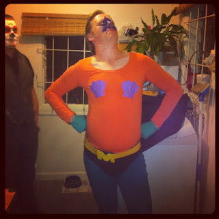 A man, with hands on hips and staunch expression, dressed as Mermaid Man from SpongeBob.