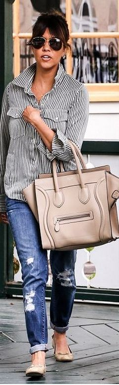 Lined shirt, jeans, hand bag and sunglasses for casual dressing
