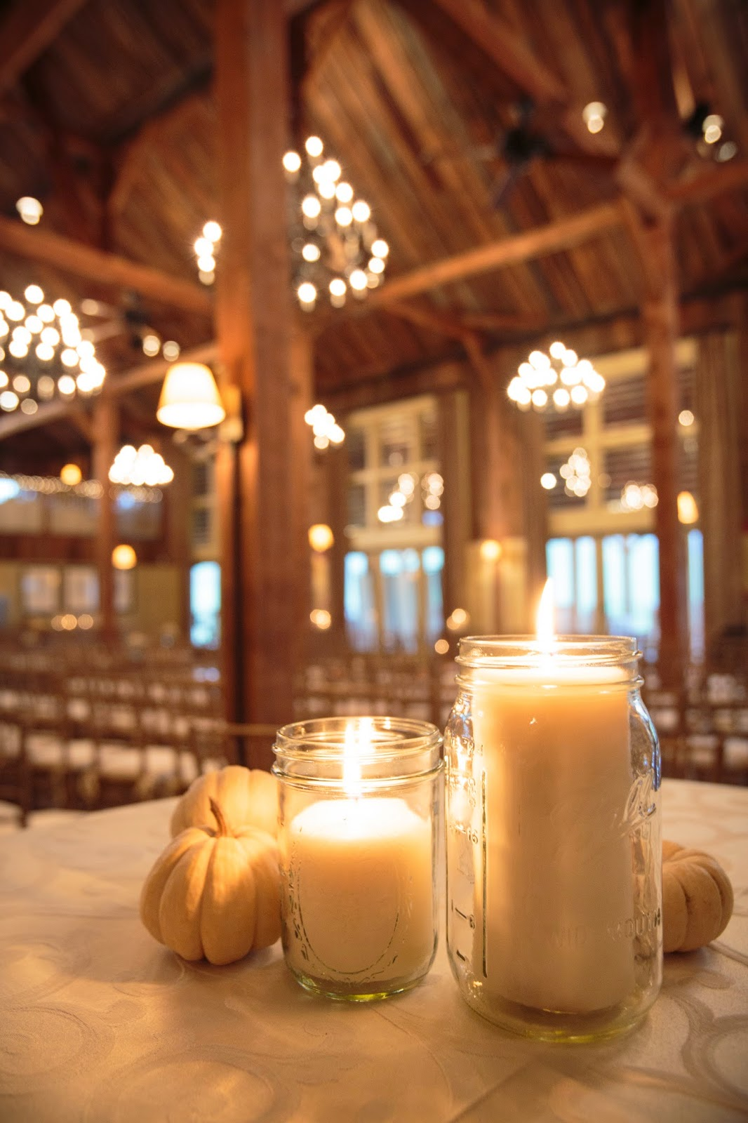 les fleurs : barn at gibbet hill : neutral fall wedding : barn wedding : mason jars with candles : mini white pumpkins