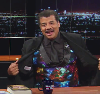 Neil deGrasse Tyson shows off his cosmic vest