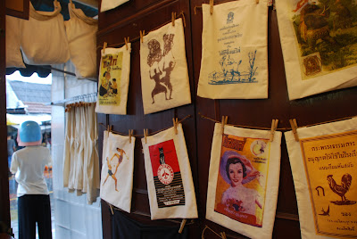 t-shirts and bags from Aui - One of Us vintage t-shirts in Bangkok's Chatuchak Market