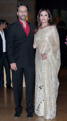 Raveena Tandon in white Silver Saree1 - Raveena Tandon with husband Anil at Vashu Bhagnani's daughter Honey Bhagnani's sangeet