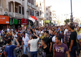 مظاهرات بسوهاج تطالب برحيل مرسى