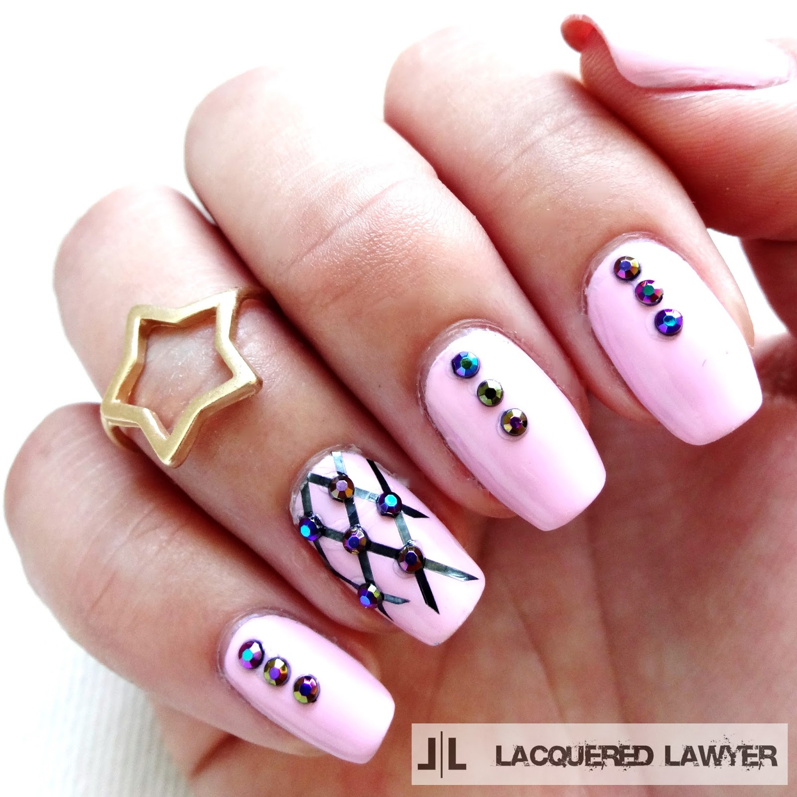 Pink nail art with iridescent studs