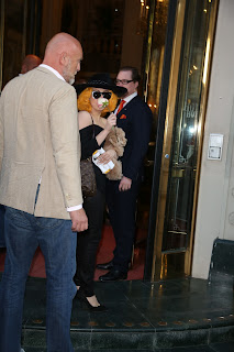 Lady Gaga holding her cute pup Fozzi and a white rose