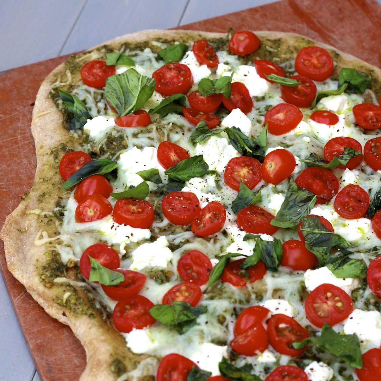 White Pesto Pizza with Tomatoes & Basil