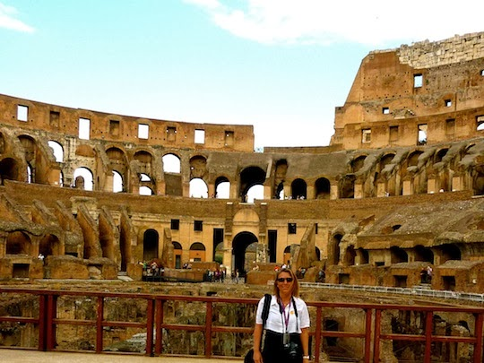 Standing on the arena in the Colosseum