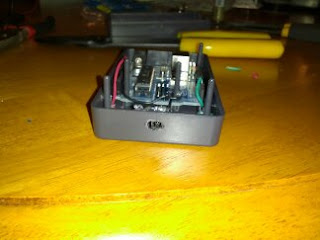 Front face of Arduino enclosure, showing the IR decoder visible through the drilled slot.