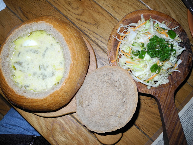 Green Borshch Served in Bread Bowl and Fresh Cabbage Salas in Old Mill Restaurant, Ternopil, Ukraine
