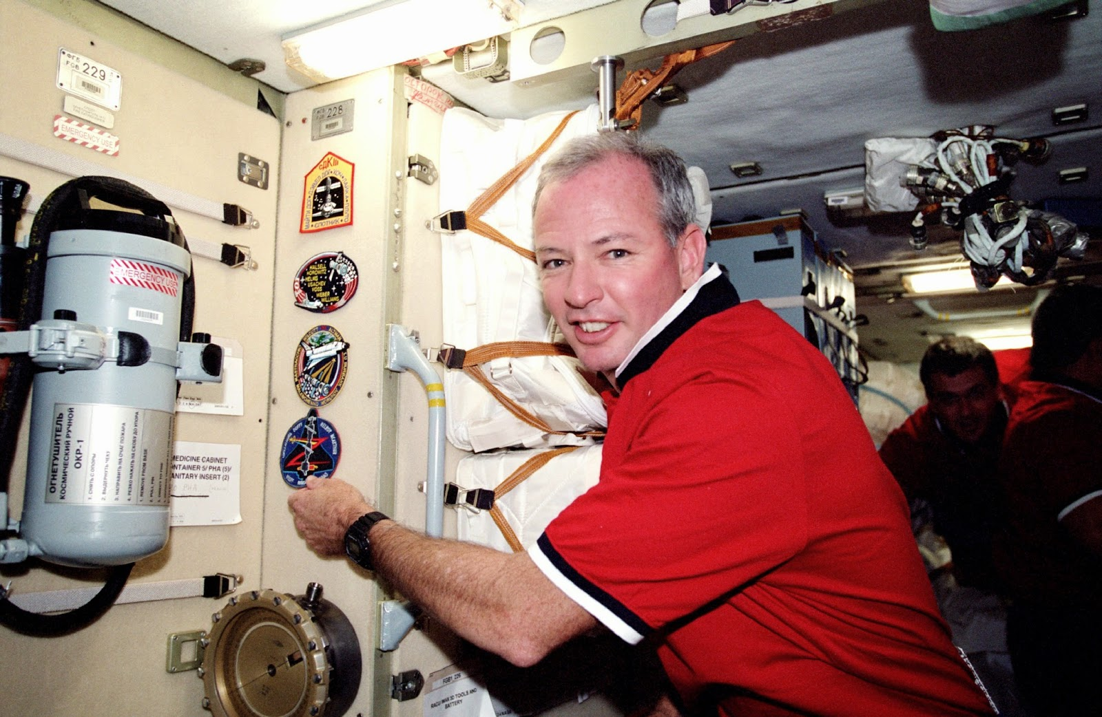 Astronaut Brian Duffy, mission commander, adds the STS-92 patch to the growing collection of those representing Shuttle crews who have worked on the International Space Station (ISS). A location in the functional cargo block (FGB) or Zarya serves as the traditional posting site for the patches. Credit: NASA