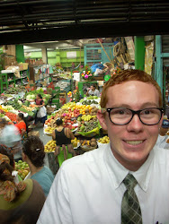 Elder Yates in front of fruit stand