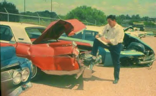 Insurance adjuster adjusting the damage to the adjusted car