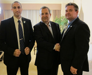 Special Agent Paul Davis (r) poses with Israeli Defense Minister Ehub Barak (center) and an Israeli Shin Bet officer.