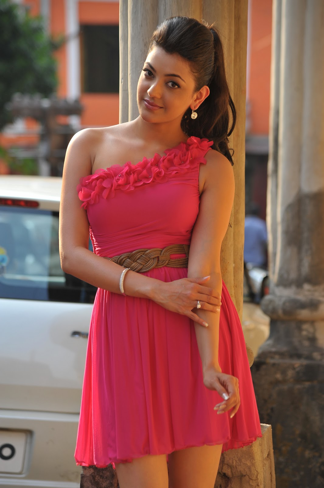 Kajal Agarwal in Pink Short Skirt in Businessman Movie Photoshoot