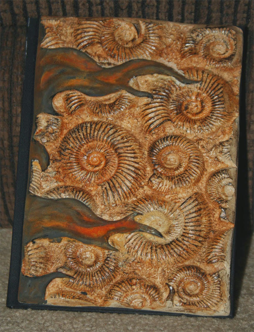 05-Small-Fossil-Notebook-Tim-Baker-Intricately-Designed-Book-Covers-www-designstack-co