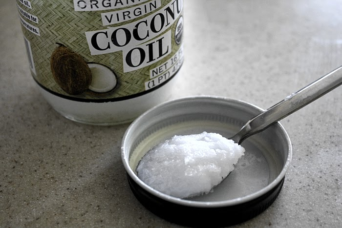 oil pulling coconut oil sesame oil natural teeth whitening at home bad breath remedy health benefits