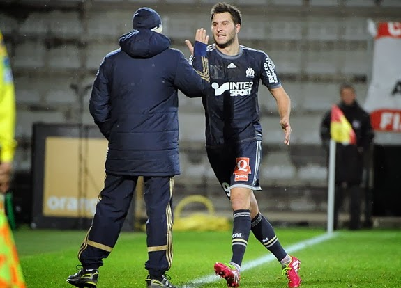 André-Pierre Gignac celebrates after scoring against Ajaccio with Marseille coach Elie Baup
