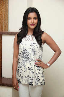 Priya Anand beautiful in white top white denim leggings at Oru Oorla Rendu Raja Interview