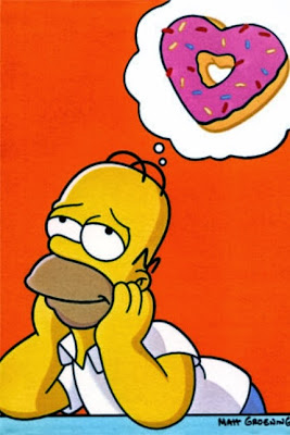 Homer Simpsons dreaming of love shaped donuts