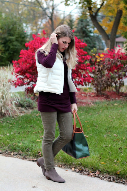 burgundy tunic sweater, camo pants, white putter vest, booties