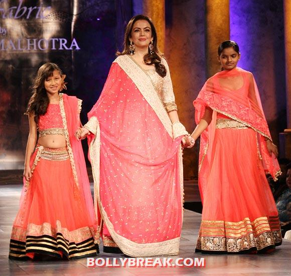 Nita Ambani walks the ramp for Manish Malhotra, escorting two young girls from the village of Mijwan down the runway at the Mijwan -- Sonnets in Fabric showing in Mumbai last night - Priyanka, Dia, Parineeti & other Celebs catwalk for a cause