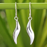 http://jewelry.novica.com/earrings/dangle/sterling-silver-dangle-earrings-sea-current/198919/
