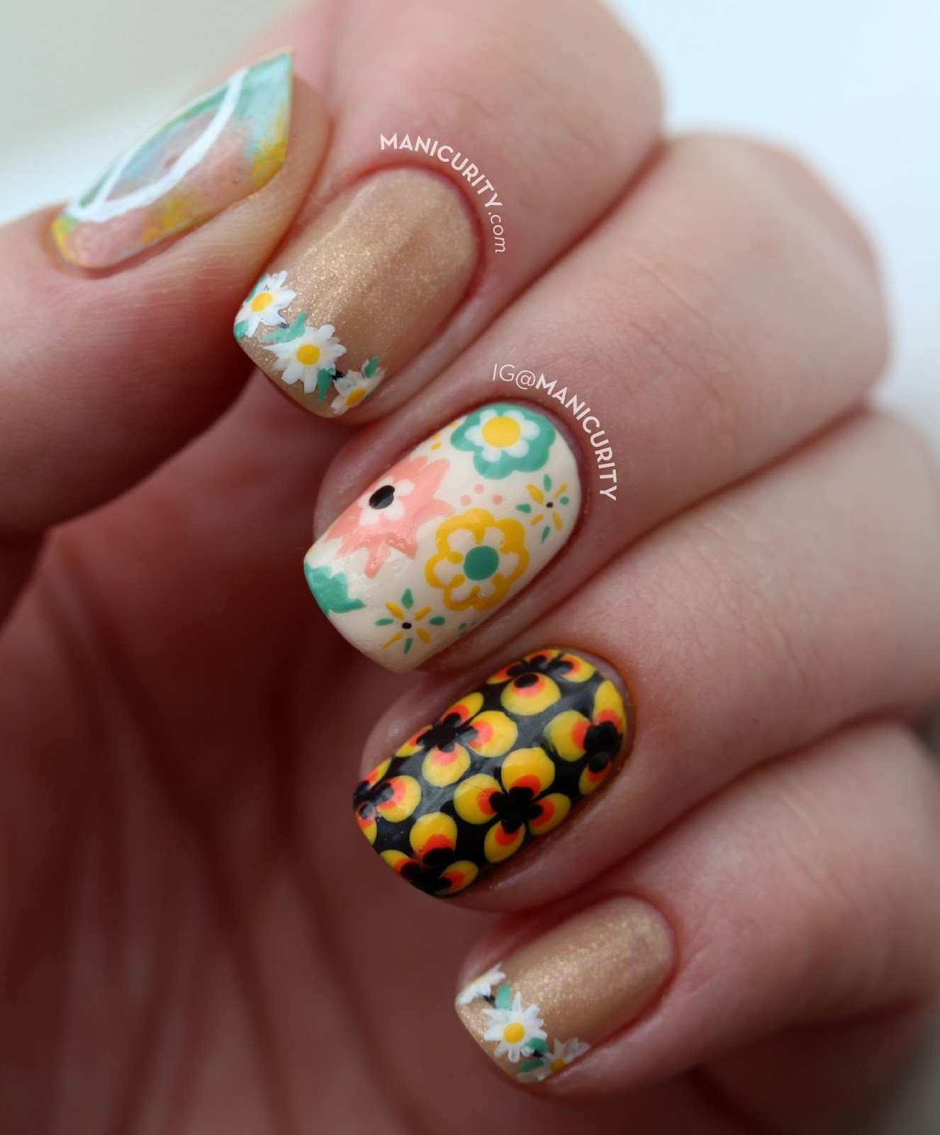 The Digit-al Dozen: Can You Dig This Freehand Seventies Skittle Set of Nail Art? Totally Groovy! Featuring a pastel floral french nail design and funky dot accent nail | Manicurity.com
