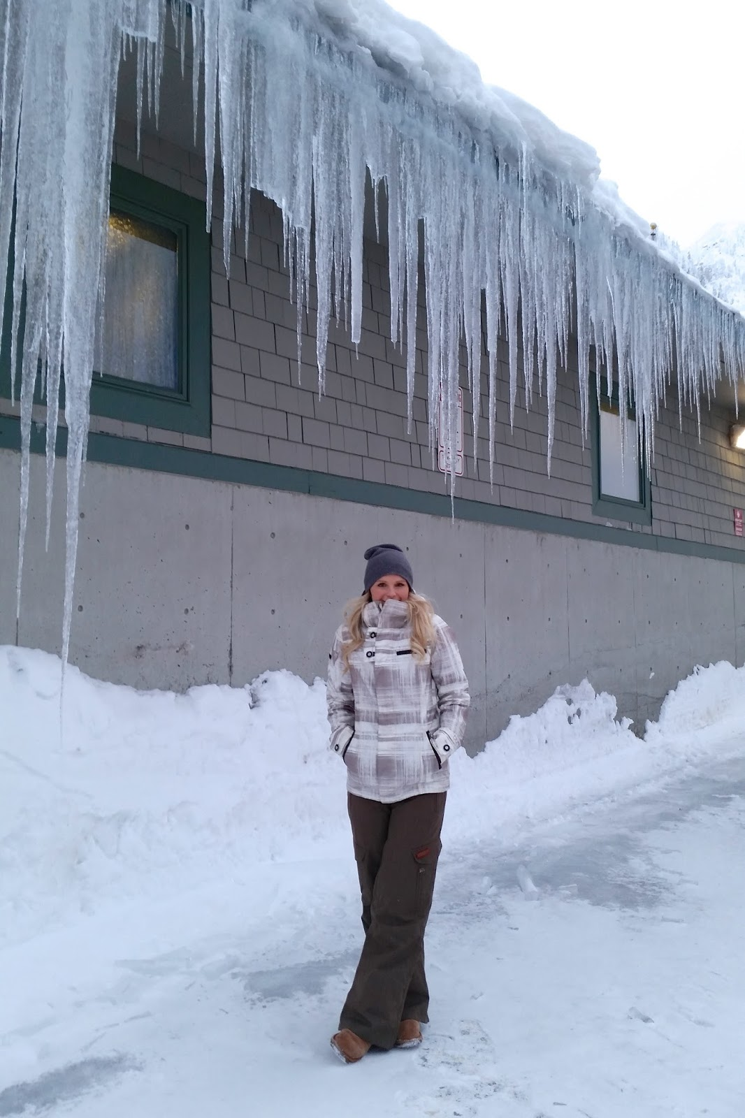 huge icicles on the side of a lodge in washington