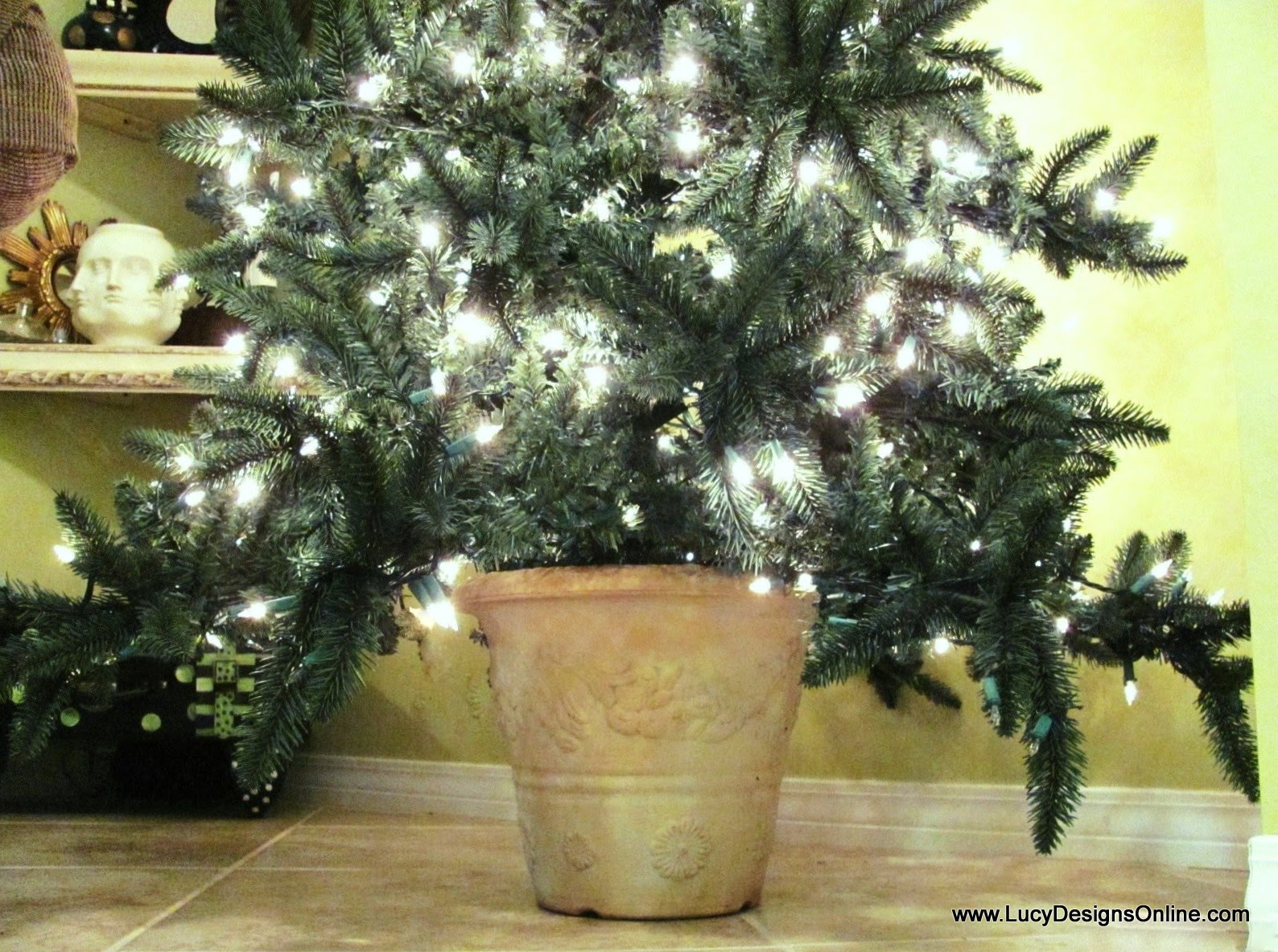Artificial christmas tree in a planter pot diy lucy designs christmas tree in an urn or pot how to diy solutioingenieria Choice Image