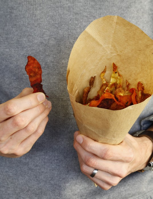 A hand-held cone of root vegetable crisps