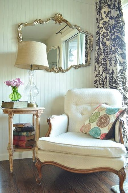 classic and elegant reading corner with big white armchair
