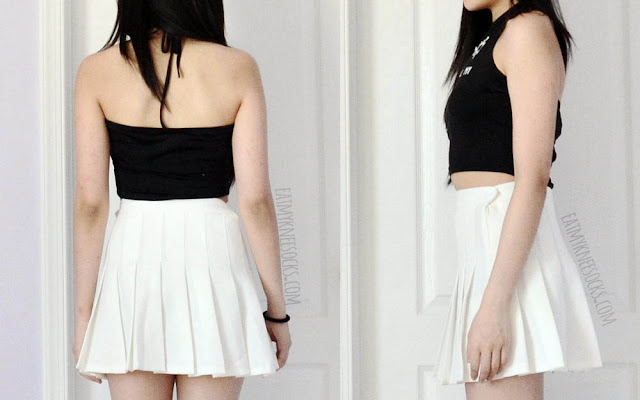 Back and side views of the black halter-neck crop top from Dresslink, paired with a white American Apparel pleated tennis skirt.