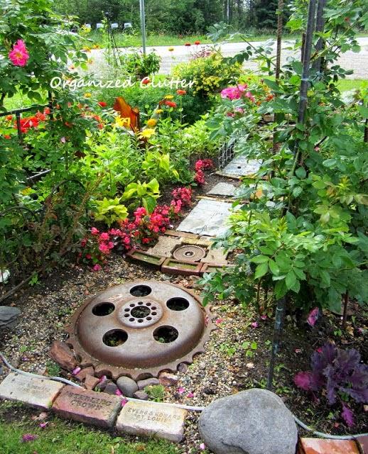 A Junky Garden Pathway www.organizedclutterqueen.blogspot.com