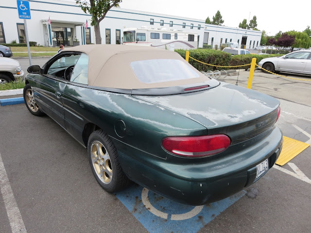 Peeling paint on Chrysler Sebring Convertible before repainting at Almost Everything Auto Body