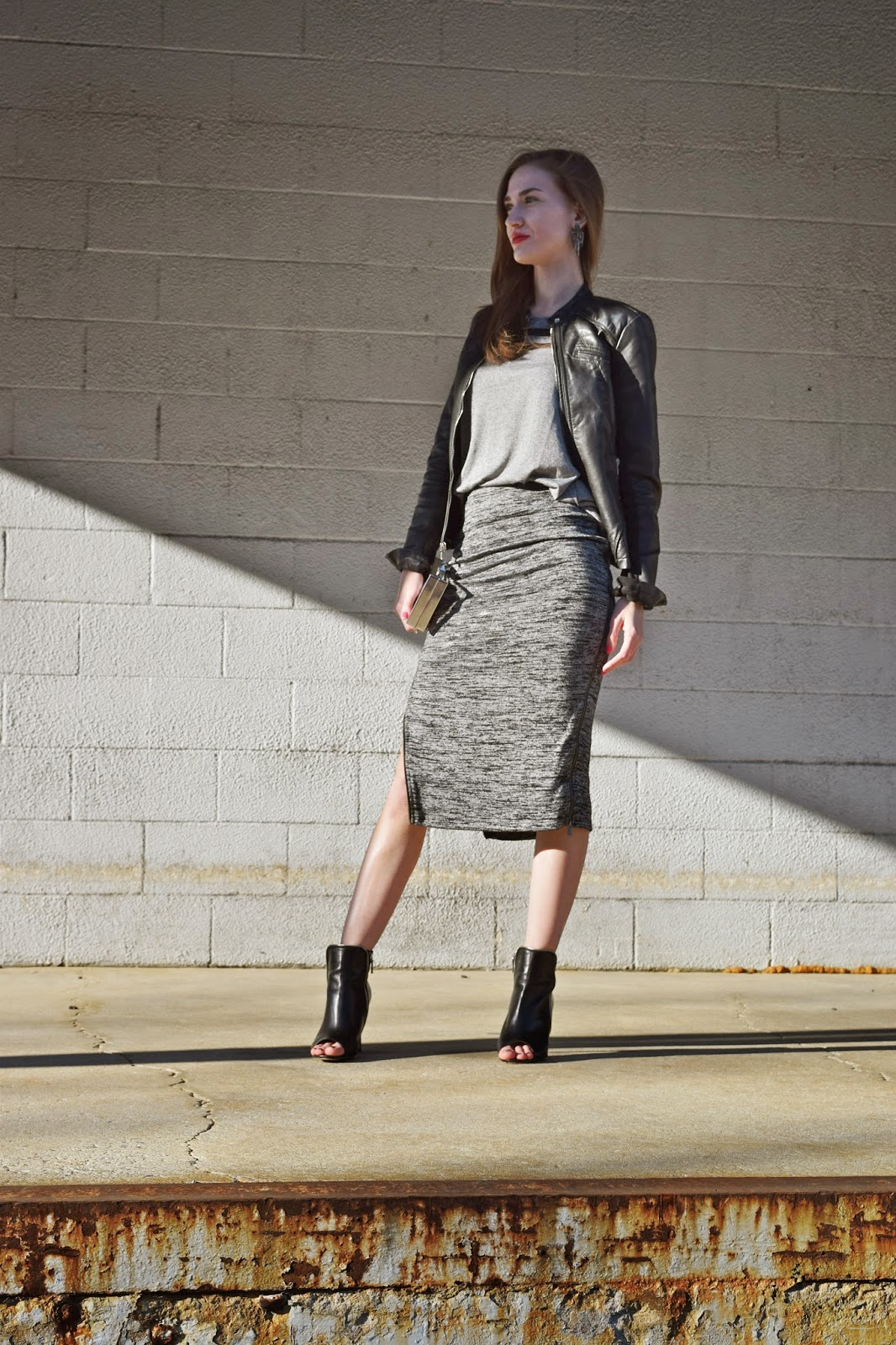 wearing Express faux leather moto jacket, H&M Varsity mesh t-shirt, Express side zip skirt, halogen ankle booties