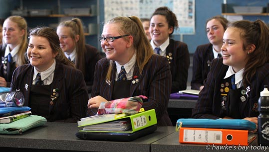 L-R: Abby Lamb, Hannah Davis, Sophie Jarvis - A science class listens to Gemma Wynne-Lewis, a Hastings masterchef contestant, who spent a day at her former school, Iona College, Havelock North. photograph