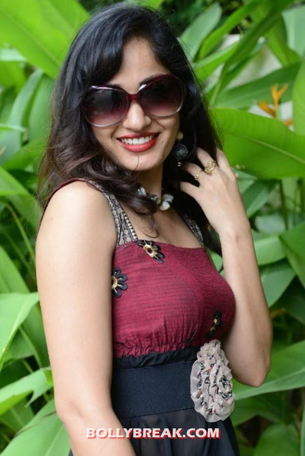 Madhavi Latha in black and maroon looking like a diva promoting her new film - Madhavi Latha Movie Launch Photos